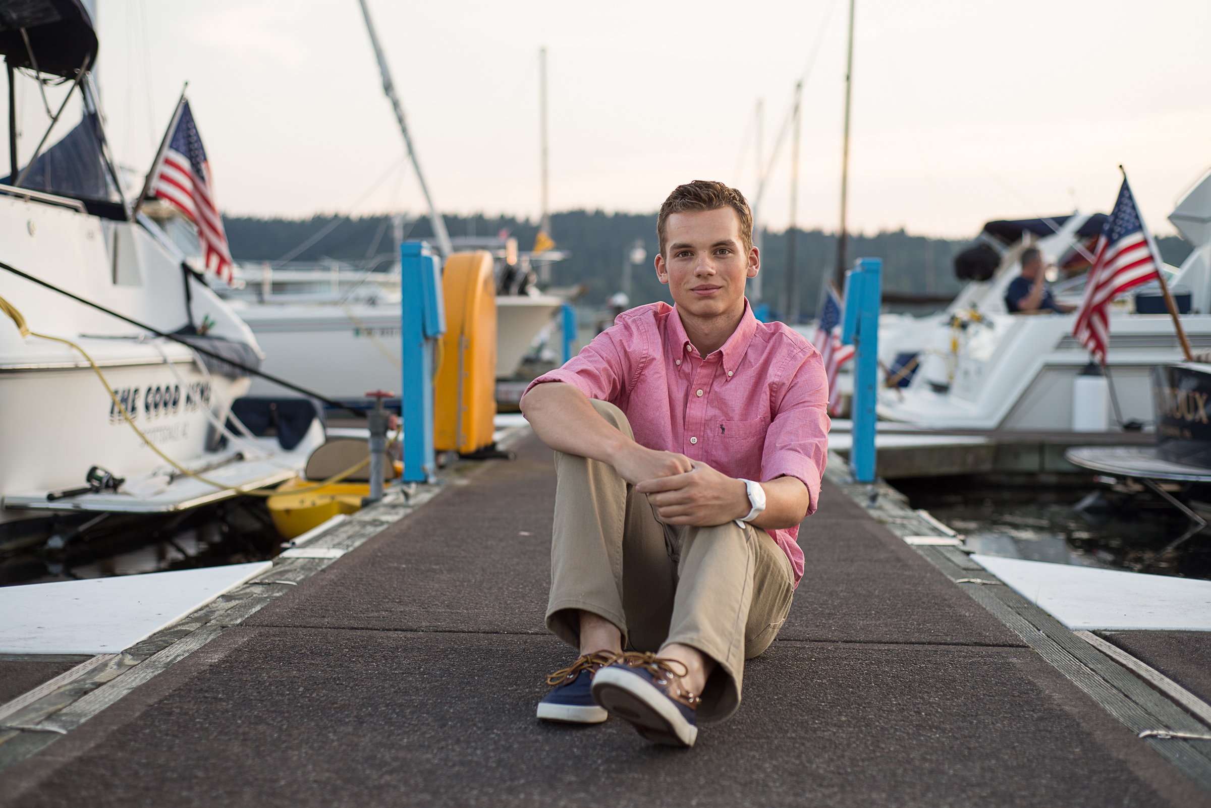 Senior boy on marina dock