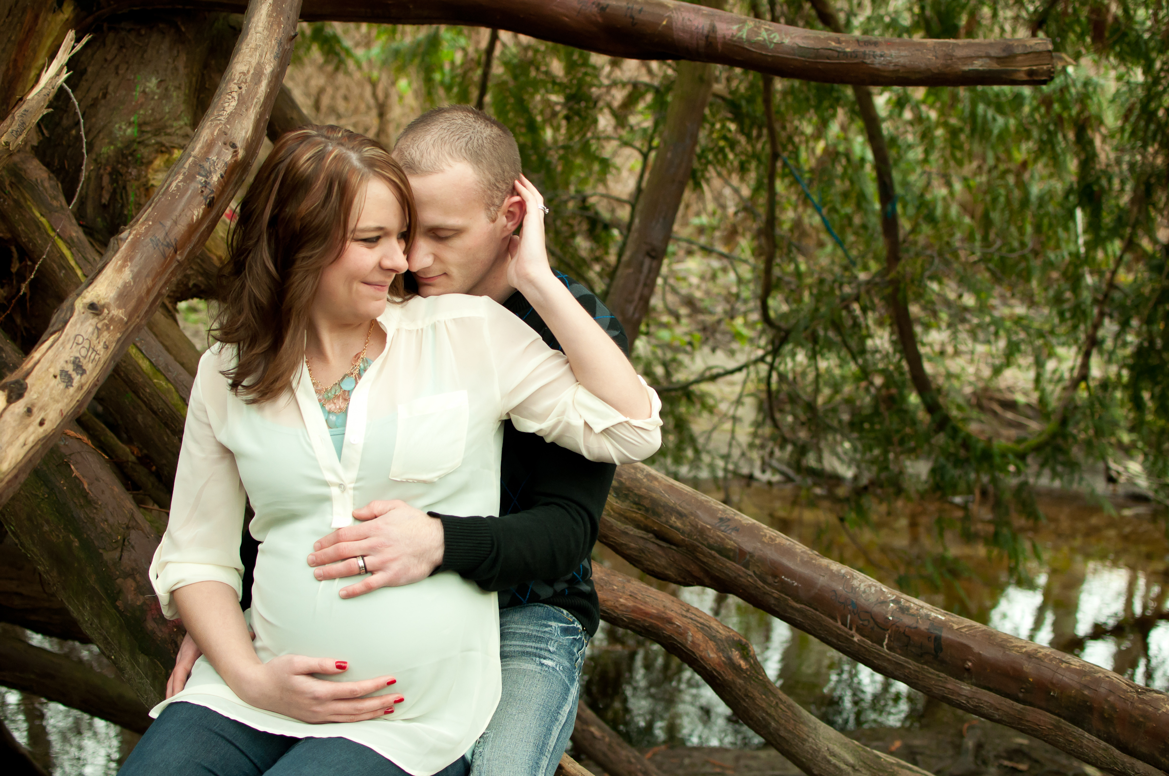 Maternity couple in the woods