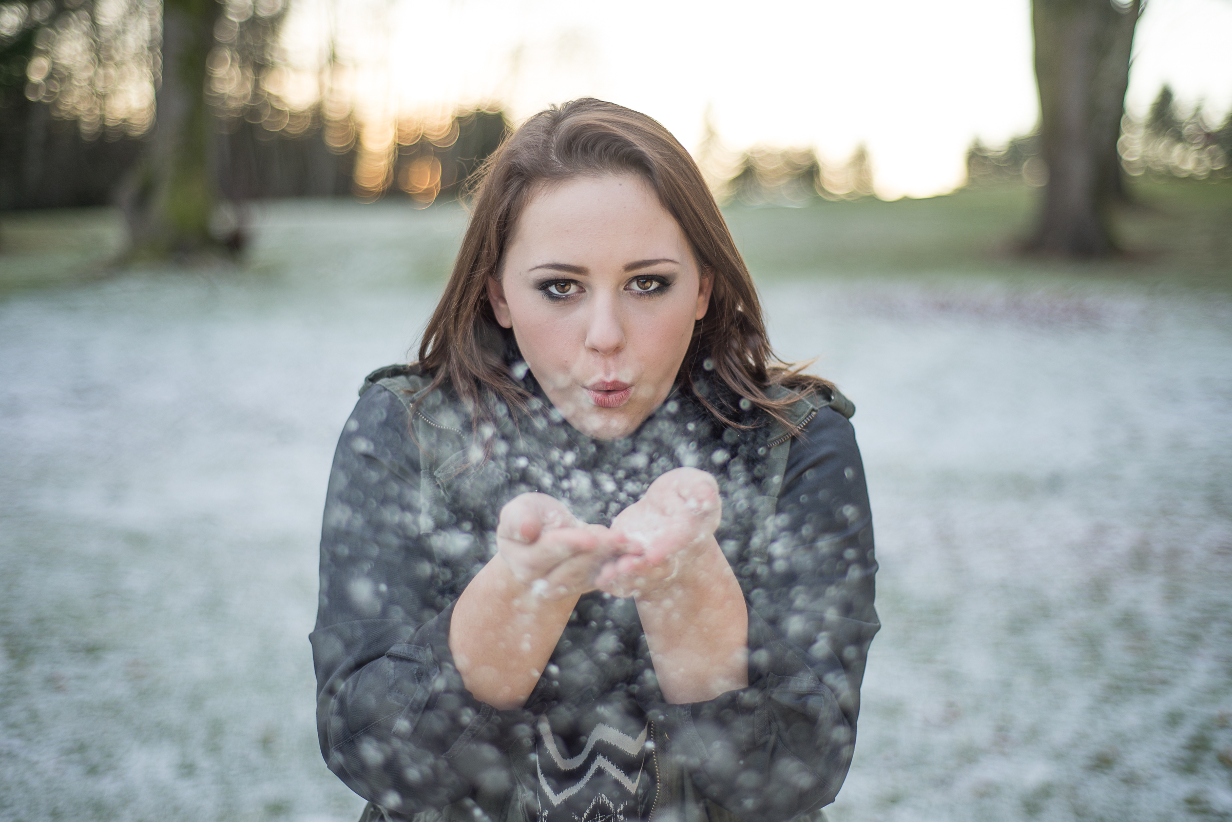 Senior girl blowing dandylions