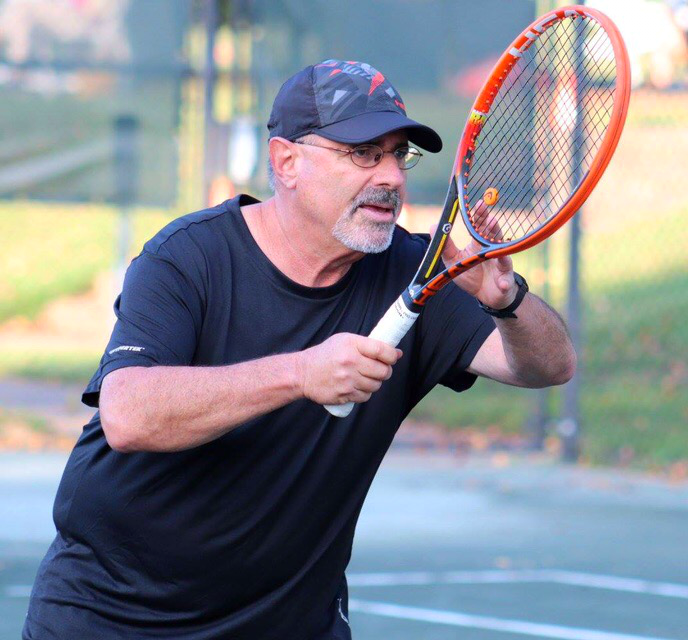 Steven Rochkind playing tennis.