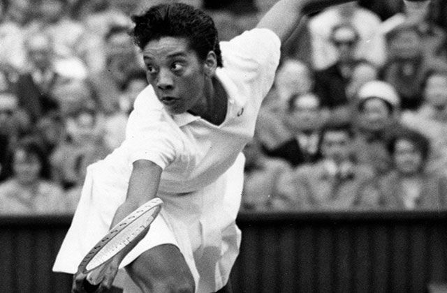 6/27/1957-London, England- Althea Gibson, in action at Wimbledon