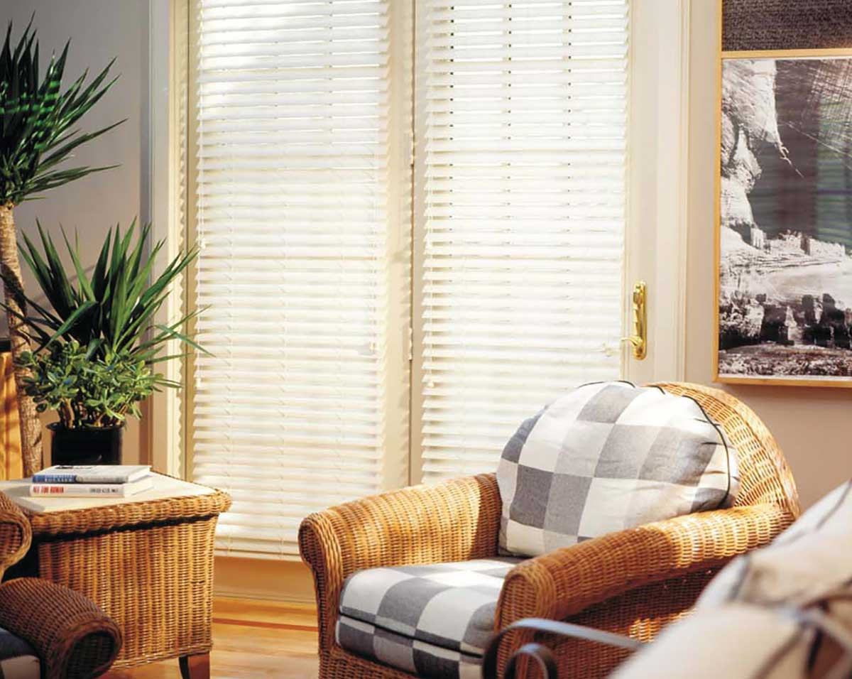 white-wood-blinds-covering-glass-door.jp