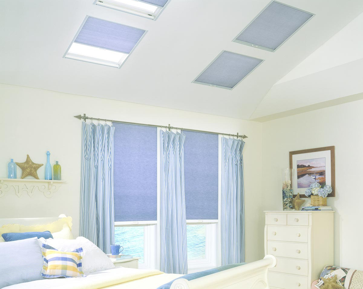 skylight-honeycomb-shades-bedroom-with-c