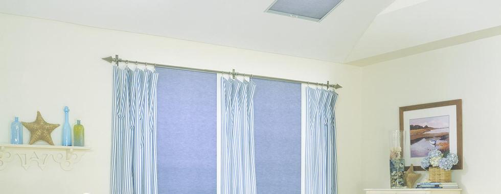 skylight-honeycomb-shades-bedroom-with-c