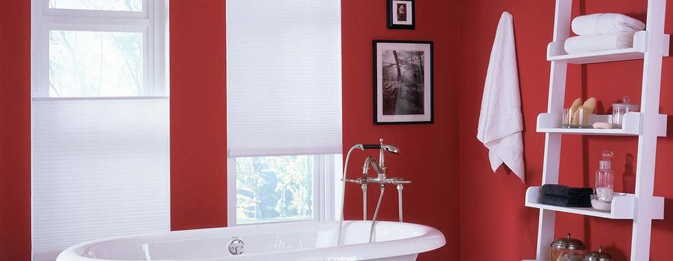 white-honeycomb-shades-master-bathroom.j