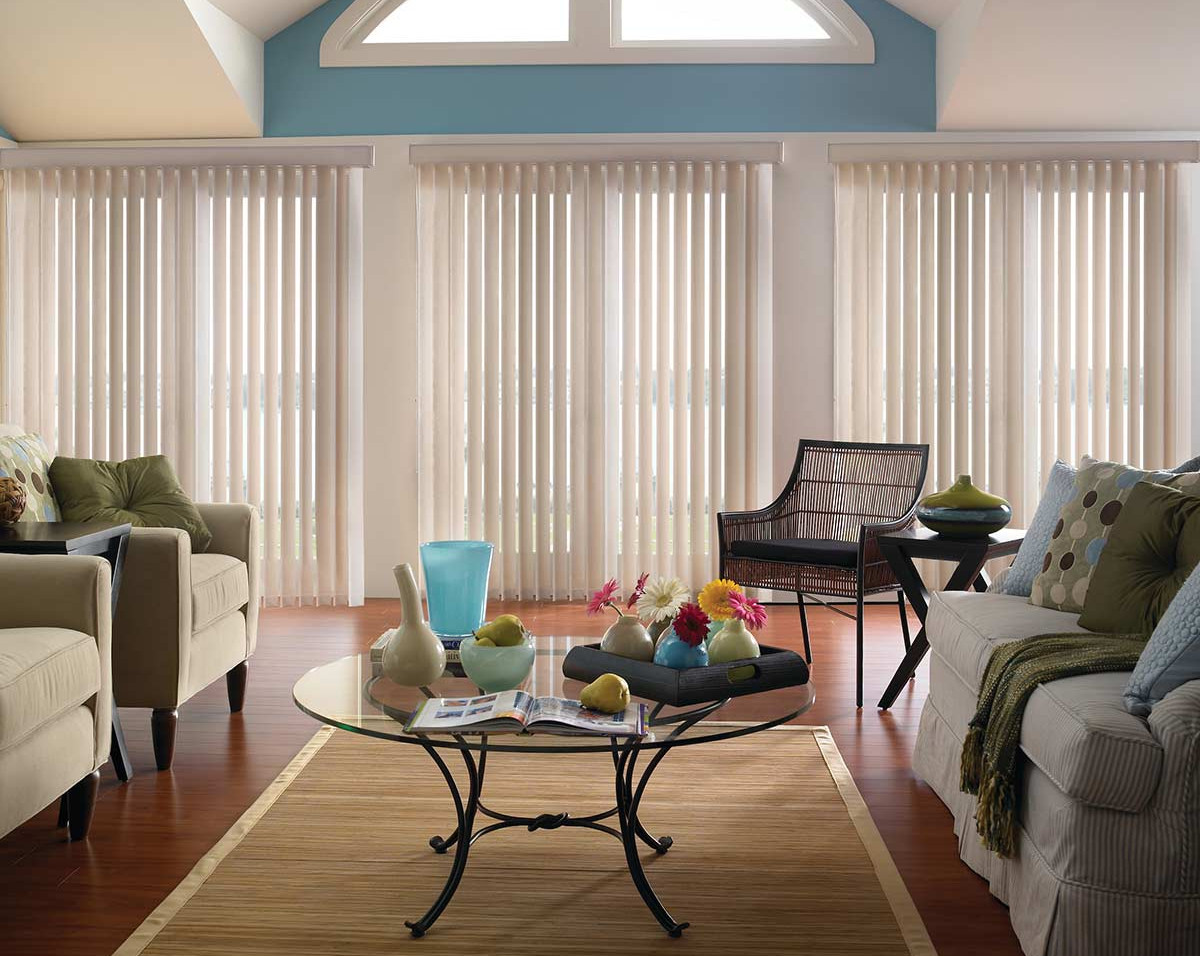 three-white-vertical-blinds-living-room.