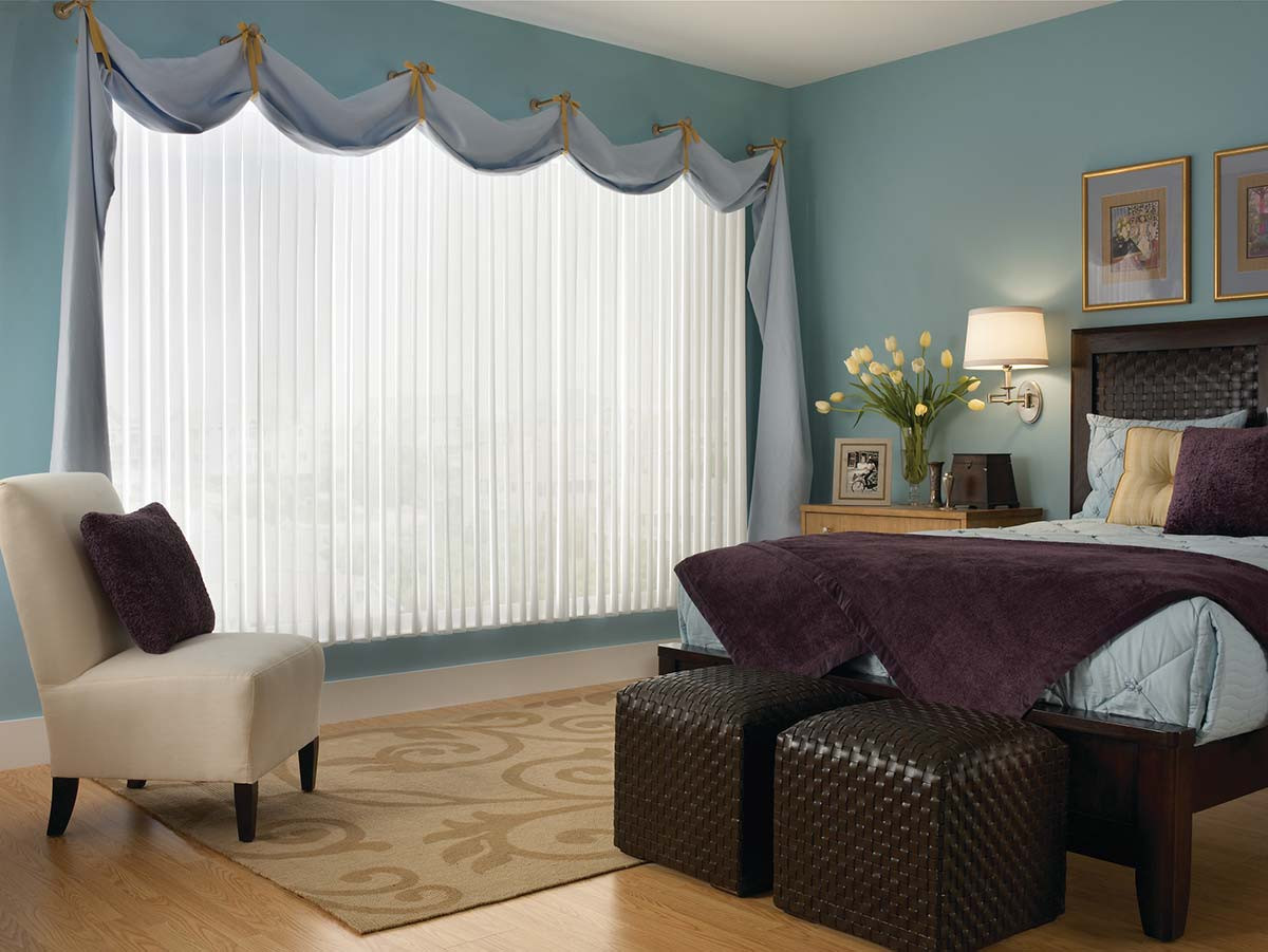 white-vertical-sheer-covered-by-curtains