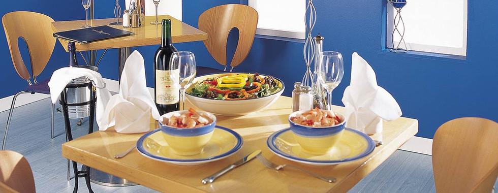 white-roller-shades-blue-restaurant.jpg
