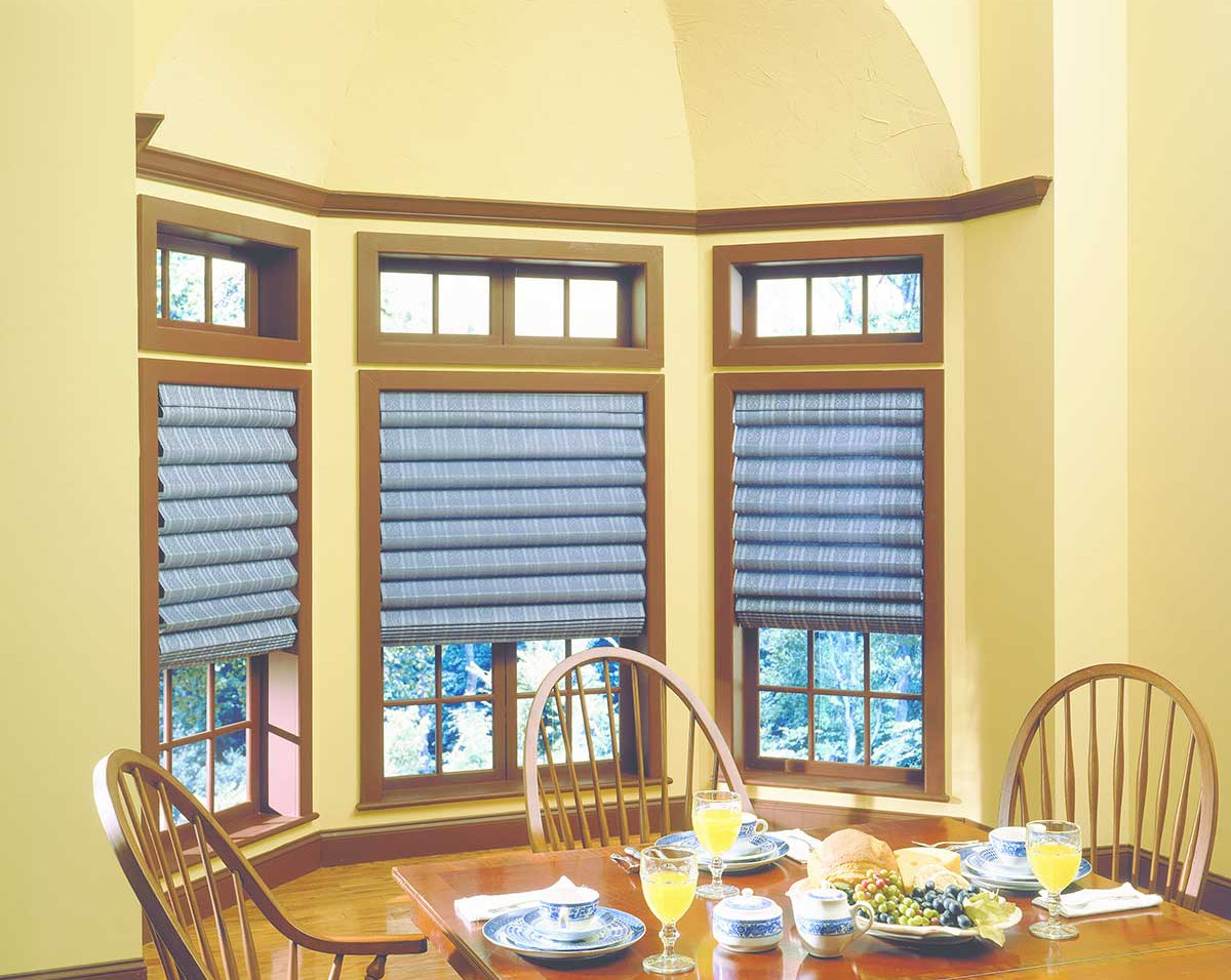 patterned-blue-hobbled-roman-shades.jpg