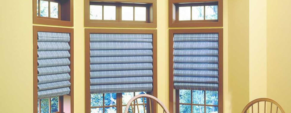 patterned-blue-hobbled-roman-shades.jpg
