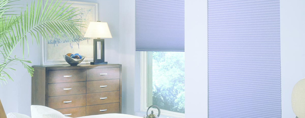 light-blue-honeycomb-shades-bedroom.jpg