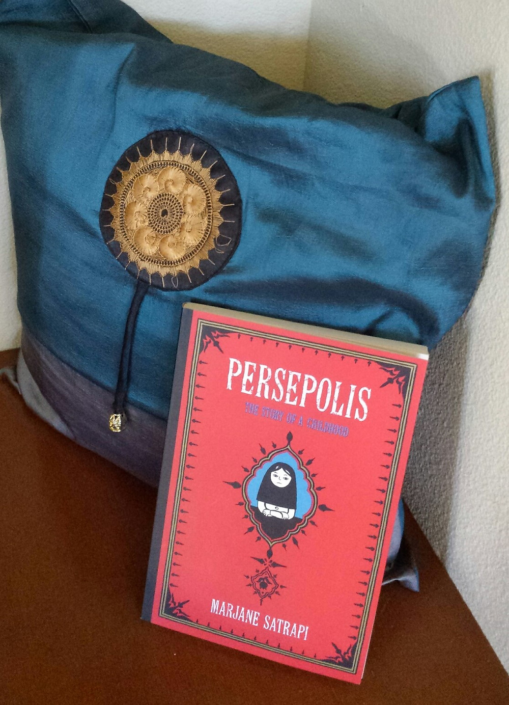 Persepolis graphic novel and Persian-style pillow.