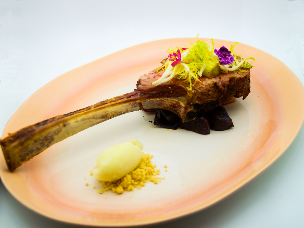 Sommelier Toronto, 100 + days aged Ribeye on top of purple potatoes and popcorn sherbet.