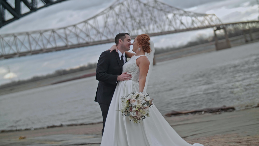 Bride and Groom Under Bridge