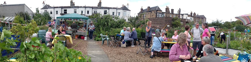 Open Day panoramic photo of the Community Plot with visitors
