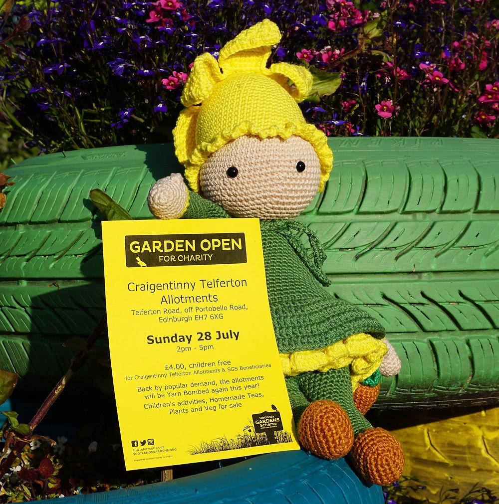 Mascot holding an Open Day Flyer
