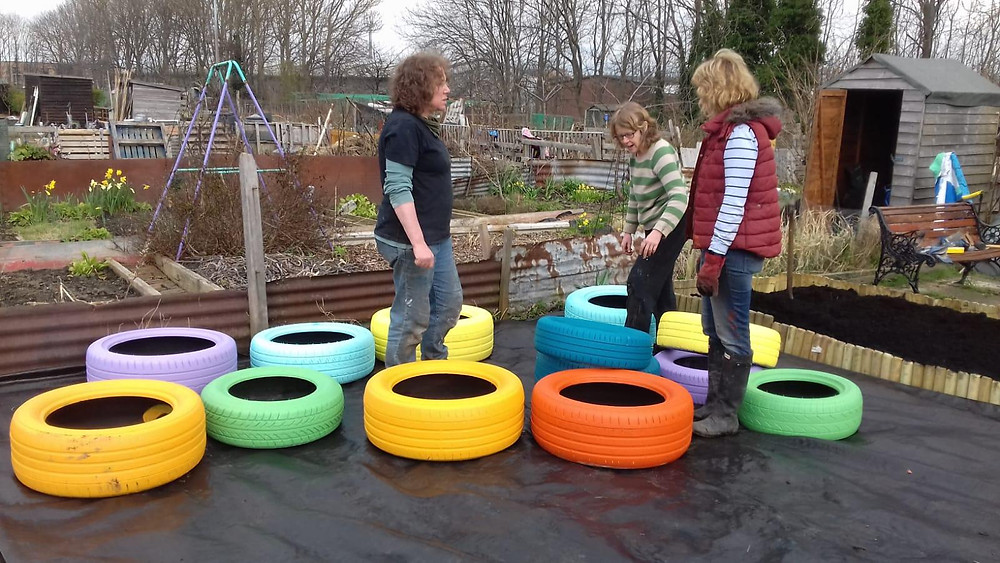 colourful tyre planters
