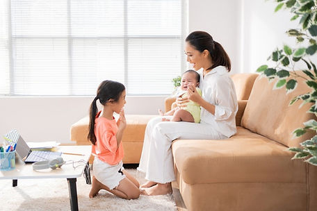 asian-family-relaxing-from-online-learni