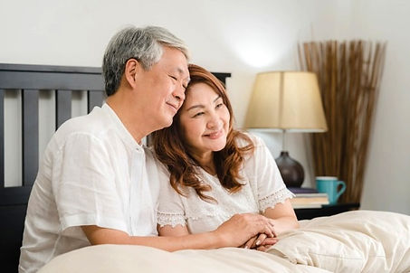 asian-senior-couple-talking-bed-home-asi