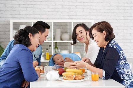 happy-asian-family-breakfast-table_1098-