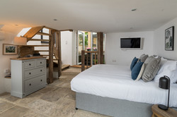 Bedroom 3 with open staircase to 4