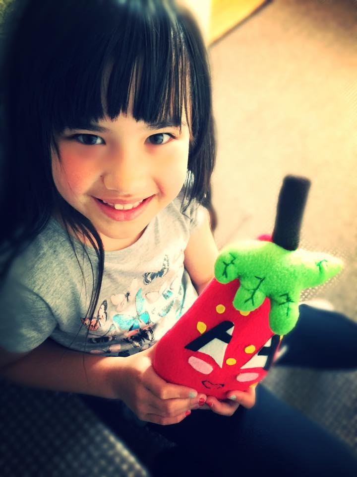 Eryka 7 and her strawberry doll