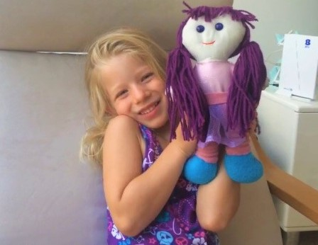 Avi and her purple doll