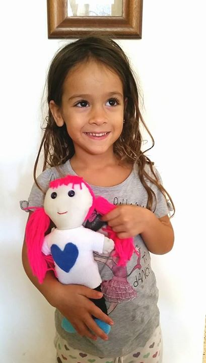 Shiri and her pink doll