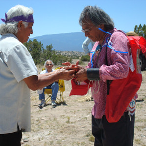 Water blessing ceremony at the Hamaatsa well after it was completed.  Larry Littlebird offers the first water to Pueblo elders in attendance.