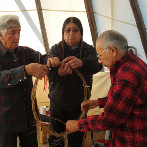 Beloved Pueblo elders, Stanley Lucero and Phil Duran in the Hamaatsa Lodge with Larry Littlebird. Making a willow council hoop.  We hold these two dear elders in our hearts with loving memories.