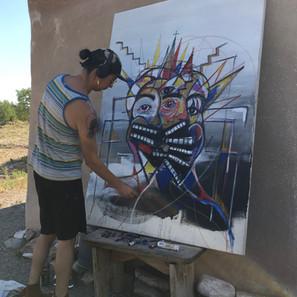 Jesse Raine Littlebird painting and creating at Hamaatsa.