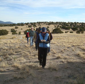 Walking pilgrimage, carrying water to an ancient stone Water Catchment on the lands of Hamaatsa for prayer and blessing.
