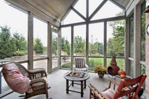 Screen porch in luxury home with patio view