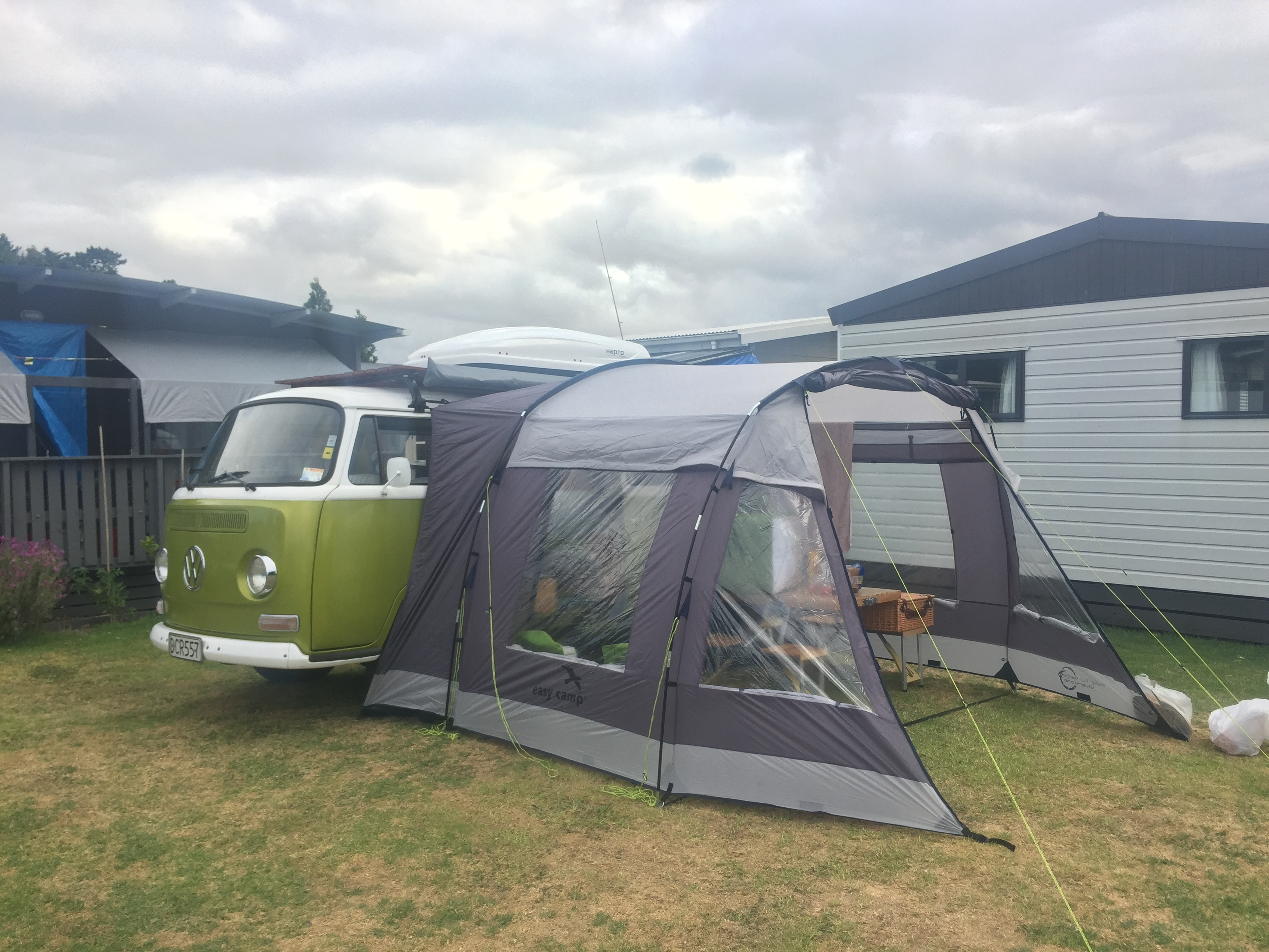 Easy erected drive away awning