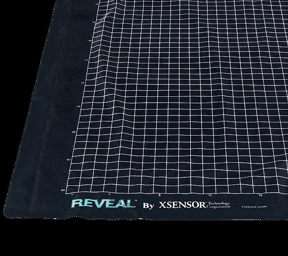 XSENSOR REVEAL PX100-series mattress surface sensor on a black background.