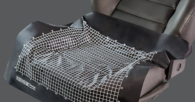 XSENSOR's high-accuracy and conformable LX100:40:40 pressure imaging sensor on the surface of a vehicle seat.