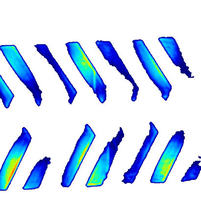 2D data visualization of an industrial vehicle track showing different levels of pressure within the track and tread design.