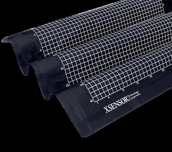 XSENSOR's LX100:40:40 pressure imaging seat sensor on a black background.