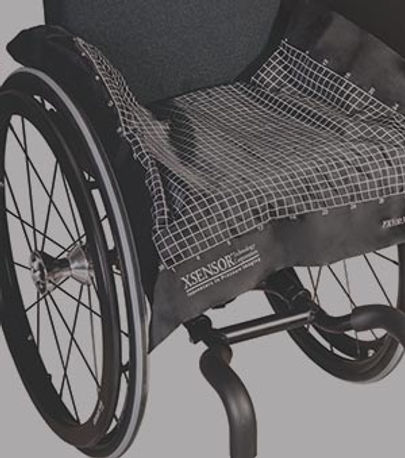 XSENSOR's LX100:40:40 pressure imaging sensor on the surface of a wheelchair seat.