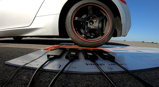XSENSOR's High-Speed Tire Testing System on a test runway as a vehicle drives over the sensor with its front-passenger tire.