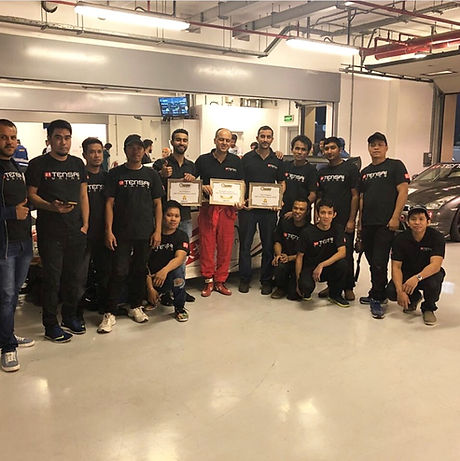 A Group photo of the Tensai Family after winning in The UAE Time Attack