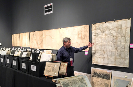 Charlie Neuschafer in the New World Maps booth