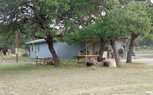 BUNKHOUSE FOUR BEHIND TREES Jetton Ranch