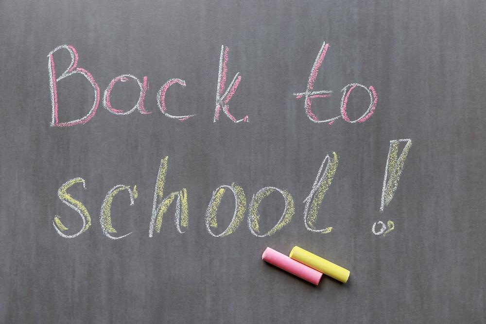 "A chalkboard with ""Back to shool"" written on it."