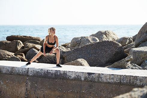 Girl Stretching at Beach