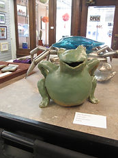 Smiling green ceramin frog