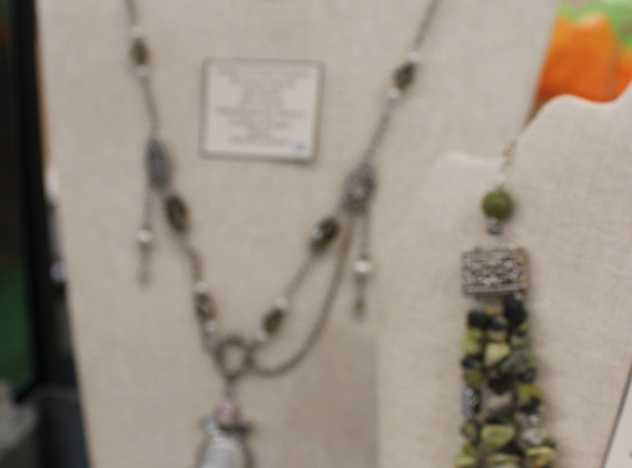 Green beaded necklaces.