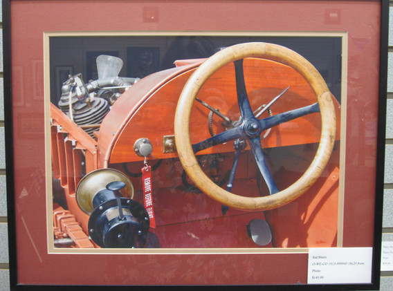 Framed photo of a vintage race car.