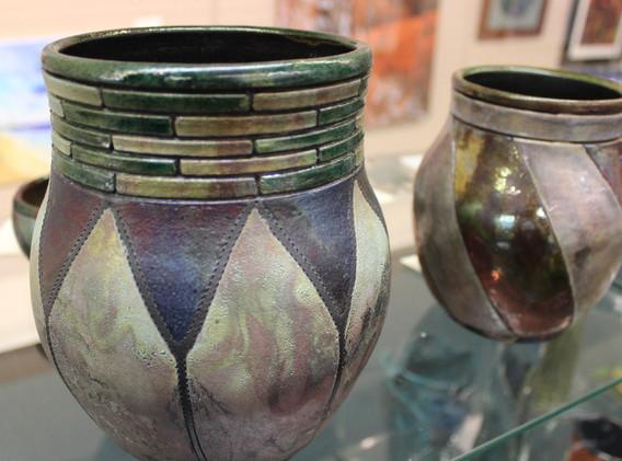 Two colorful ceramic vases.