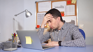 videoblocks-tired-office-worker-using-la